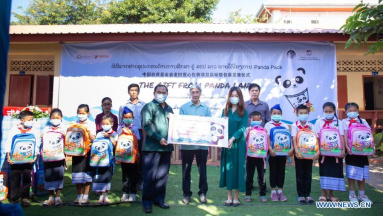 Chinese group gifts Panda Packs to Lao students